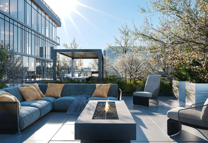 Outdoor Terrace Lounge with Fireplace and Sectional Sofa at Distrikt Trailside Condos 2