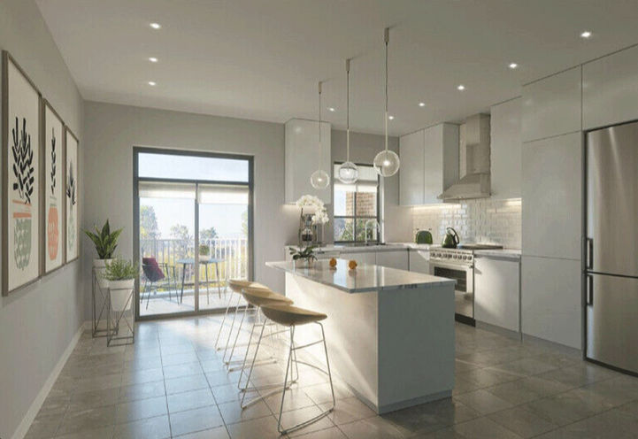Unit Interiors Showcasing Kitchen with Island, Stools, and Appliances