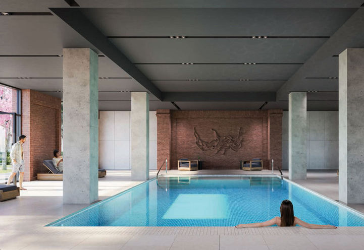 Ground Level Indoor Pool with Sun Loungers at Notting Hill Condos 3