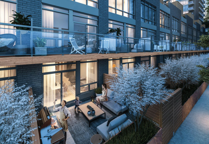 View of backyard and balconies at UltraSonic Townhomes
